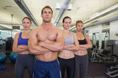 Serious fitness class posing together — Stockfoto