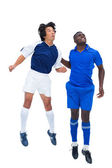 Football players tackling for the ball — Stock Photo