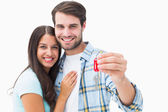 Happy young couple holding new house key — 图库照片