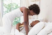 Intimate couple messing about in the morning on bed — Stock Photo