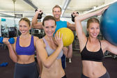 Fitness class posing with different equipment — Stock Photo