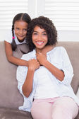 Pretty mother sitting with her daughter — Stock Photo