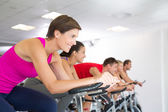 Spin class working out and smiling — Stock Photo