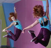 Pretty break dancer jumping up and looking in mirror — Stock Photo