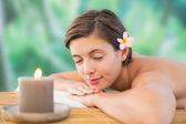Close up of a beautiful woman on massage table — Stock Photo