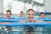 Fitness class doing aqua aerobics — Stock Photo