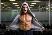 Muscular man shouting in health club — Stock Photo