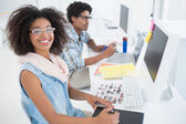 Happy design team working at desk  — Stock Photo