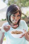 Pretty woman having her breakfast outside — Stock Photo