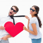Brunette pulling her boyfriend by the tie holding heart — Stock Photo #50060433