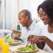 Happy family enjoying a healthy meal together — Stock Photo #50061247