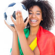 Pretty football fan with portugal flag holding ball — Stock Photo #50061699