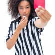 Pretty referee blowing her whistle and showing red card — Stock Photo #50061887