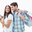 Attractive young couple with shopping bags and tablet pc — Stock Photo #50062143