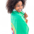 Girl wrapped up in portugal flag smiling at camera — Stock Photo #50062353