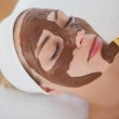 Beautiful blonde getting a chocolate facial treatment — Stock Photo #50062621