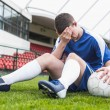 Disappointed football player in blue — Stock Photo
