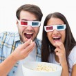 Attractive young couple watching a 3d movie — Stock Photo #50062765