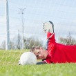 Goalkeeper in red making a save — Stock Photo #50063071