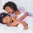 Cute daughter sleeping with mother on the sofa — Stock Photo #50063181