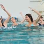 Fitness class doing aqua aerobics — Stock Photo #50063233