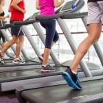 Row of people on treadmills — Stock Photo