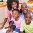 Happy family using the laptop together — Stock Photo #50063459
