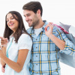 Attractive young couple with shopping bags and tablet pc — Stock Photo #50063647