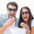 Attractive young couple watching a 3d movie — Stock Photo #50064065