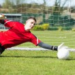 Goalkeeper in red saving a goal during a game — Stock Photo #50064723