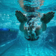 Athletic swimmer training on her own — Stock Photo #50065073