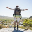 Hiker standing at the summit — Stock Photo #50065109