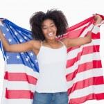 Pretty girl holding american flag cheering at camera — Stock Photo #50065275