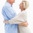 Happy mature couple hugging and smiling — Stock Photo #50065295