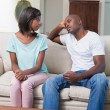 Unhappy couple not talking after argument on sofa — Stock Photo
