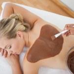 Beautiful blonde enjoying a chocolate beauty treatment — Stock Photo #50065679