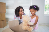 Daughter unpacking her teddy — Stock Photo