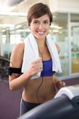 Fit brunette running on the treadmill — Stock Photo