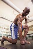 Shirtless muscular man at gym — Stock Photo