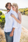 Couple embracing by the road — Stock Photo