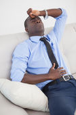 Tired businessman getting a headache — Stock Photo