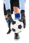 Goalkeeper picking up the ball — Stock Photo