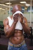 Muscular man wiping sweat after workout — Stock Photo