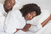 Happy couple sleeping together in bed — Stock Photo