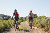 Active couple cycling in the countryside  — Stock Photo