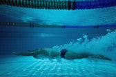 Fit swimmer training on his own — Stock Photo
