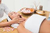 Peaceful brunette enjoying a neck massage — Stock Photo