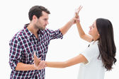 Fearful brunette being overpowered by boyfriend — Stock Photo