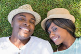 Happy couple lying in garden together — Stock Photo