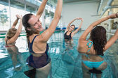 Fitness class doing aqua aerobic — Stockfoto